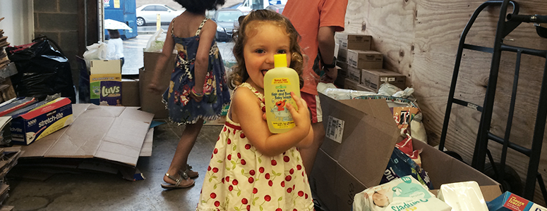Toddler girl with baby shampoo